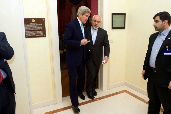 U.S. Secretary of State John Kerry walks with Iranian Foreign Minister Javad Zarif after a one-on-one meeting on April 2, 2015, in Lausanne, Switzerland, amid negotiations between the P5+1 member nations and Iranian officials about the future of their country's nuclear program. [State Department photo/ Public Domain]